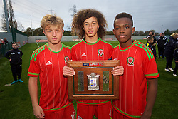 NEWPORT, WALES - Thursday, November 5, 2015: Wales' Keiron Proctor, captain Ethan Ampadu and Rabbi Matonda celebrate with the Victory Shield after a 3-1 victory over Northern Ireland during the Under-16's Victory Shield International match at Dragon Park. (Pic by David Rawcliffe/Propaganda)