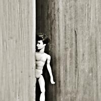 male doll in doorway