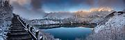 "A pond reflects snowy Mount Tate (Tate-yama or Tateyama, 3015 m or 9892 ft) on the Tateyama Kurobe Alpine Route, at Murodo, Toyama Prefecture, Chubu Sangaku National Park, Northern Japan Alps. Along with Mount Fuji and Mount Haku, Tateyama is one of Japan's ""Three Holy Mountains"" (Sanreizan). This image was stitched from multiple overlapping photos."