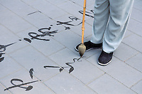 China. Beijing. Calligraphy exercice at Beihai park. // Chine. Pekin. Exercice de calligraphie dans le park Beihai.