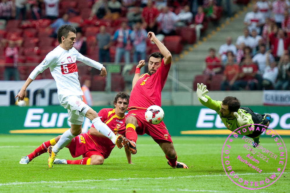 (L) Poland's Waldemar Sobota shoots on the goal during the 2014 World Cup Qualifying Group H football match between Poland and Montenegro at National Stadium in Warsaw on September 06, 2013.<br /> <br /> Poland, Warsaw, September 06, 2013<br /> <br /> Picture also available in RAW (NEF) or TIFF format on special request.<br /> <br /> For editorial use only. Any commercial or promotional use requires permission.<br /> <br /> Mandatory credit:<br /> Photo by &copy; Adam Nurkiewicz / Mediasport