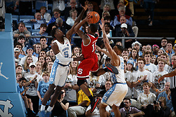CHAPEL HILL, NC - JANUARY 27: Markell Johnson #11 of the North Carolina State Wolfpack is defended by Jalek Felton #5 of the North Carolina Tar Heels on January 27, 2018 at the Dean Smith Center in Chapel Hill, North Carolina. North Carolina lost 95-91. (Photo by Peyton Williams/UNC/Getty Images) *** Local Caption *** Markell Johnson;Jalek Felton