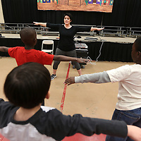 Adam Robison | BUY AT PHOTOS.DJOURNAL.COM<br /> Dance instructor Mary Frances Massey leads a group of Kindergarteners through warm up exercises before getting her class started Tuesday morning at PArkway Elementary School in Tupelo.