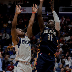 Dec 29, 2017; New Orleans, LA, USA; New Orleans Pelicans guard Jrue Holiday (11) shoots over Dallas Mavericks guard Dennis Smith Jr. (1) during the second half at the Smoothie King Center. The Mavericks defeated the Pelicans 128-120.  Mandatory Credit: Derick E. Hingle-USA TODAY Sports
