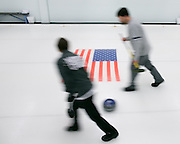 Megan Klein of Henrietta and Tim Stames of Rochester prepare to sweep a shot during a match at Rochester Curling Club on Sunday, February 8, 2015.