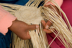 Hands weaving traditional Panama Hat of toquilla straw, Chordeleg (near Cuenca), Ecuador, South America