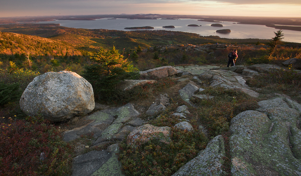 For much of the year, Cadillac Mountain in Acadia National Park, Maine is the first to receive the rays of the morning sun. No visit to the park, when the road is passable, is complete without watching the sunrise from the summit. Here, you can see the town of Bar Harbor and the islands of Frenchman's Bay.