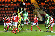 Forest Green Rovers Gavin Gunning(16) goes to head the ball but claimed by Crewe Alexanders goalkeeper Ben Garratt(1) during the EFL Sky Bet League 2 match between Crewe Alexandra and Forest Green Rovers at Alexandra Stadium, Crewe, England on 20 March 2018. Picture by Shane Healey.