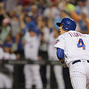 NEW YORK, NEW YORK - July 07: Wilmer Flores #4 of the New York Mets hits a three run home run in the fifth inning to the delight of his team mates in the dugout during the Washington Nationals Vs New York Mets regular season MLB game at Citi Field on July 07, 2016 in New York City. (Photo by Tim Clayton/Corbis via Getty Images)