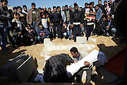 The funeral of Salama Abu Hashish, 19, takes place in Beit Lahiya, northern Gaza. Abu Hashish was shot by an Israeli sniper while grazing animals near the northern border. Due to the buffer zone approximately 30% of Gaza's agricultural land cannot be worked without severe personal risk, causing the loss of livelihoods.