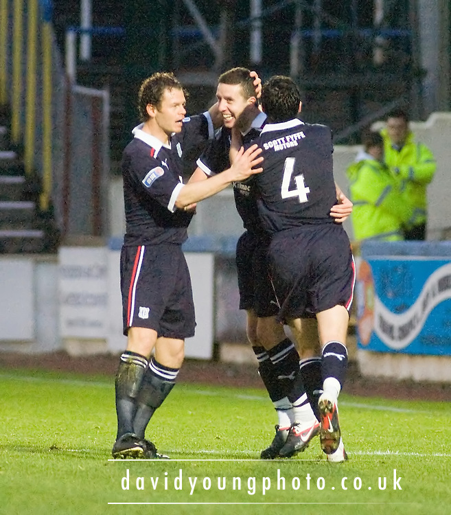 Dundee's Matt Lockwood and Stephen O'Donnell congratulate Ryan Conroy after his winning goal - Greenock Morton v Dundee - IRN BRU Scottish Football League First Division at Cappielow. .- © David Young -.5 Foundry Place - .Monifieth - .Angus - .DD5 4BB - .Tel: 07765 252616 - .email: davidyoungphoto@gmail.com - .http://www.davidyoungphoto.co.uk