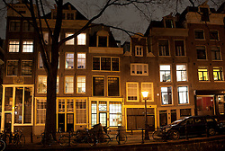 Evening view of residential buildings beside canal in central Amsterdam The Netherlands