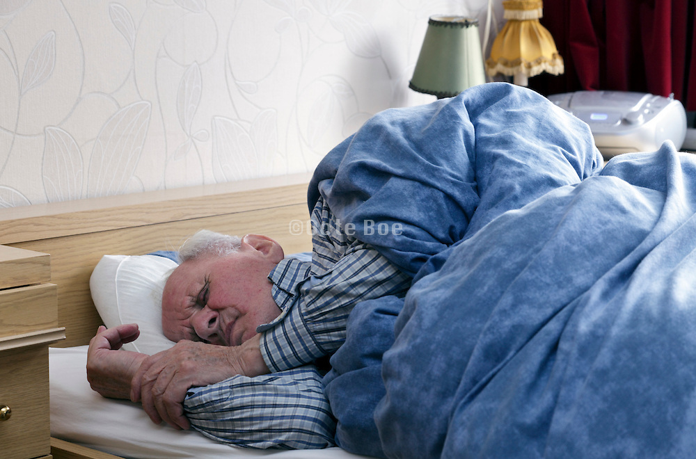 senior person taking a nap during daytime