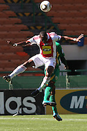CAPE TOWN, SOUTH AFRICA - 28 MARCH 2010, George Maluleka of Ajax Cape Town and Joseph Musonda of Golden Arrows challenge for the ball during the Telkom Knock Out match between Ajax Cape Town and Golden Arrows held at Newlands Stadium in Cape Town, South Africa..Photo by: Shaun Roy/Sportzpics