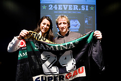 Sladzana Mihajlovic of Rdeca zoga and Tomaz Vnuk at press conference presenting auction of his ice-hockey jerseys for the Red ball Fundation, on December 1, 2009,  in Ljubljana, Slovenia.   (Photo by Vid Ponikvar / Sportida)