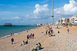 © Licensed to London News Pictures. 15/09/2016. Brighton, UK. Members of the public relax and enjoy the sunshine on the beach in Brighton and Hove. Photo credit: Hugo Michiels/LNP