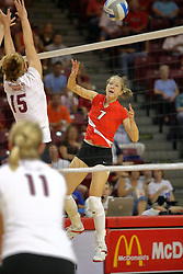 22 September 2007: M.C. Richmond is air borne and sends the ball past Cara  Hackmann in the direction of Sara Thomas. In a nip and tuck match, the Missouri State Bears beat the Illinois State Redbirds 3 games to one at Redbird Arena on the campus of Illinois State University in Normal Illinois.
