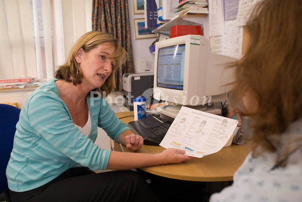 Doctor advising patient at GP practice; Brighton UK
