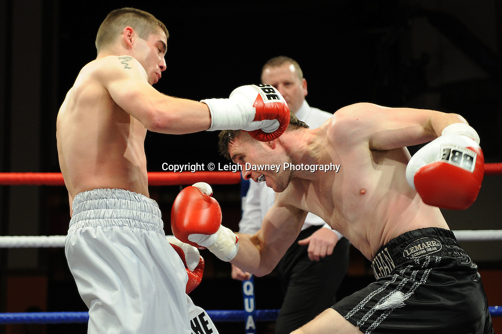 Ryan Farrag (silver shorts) defeats Marc Callaghan in a Super  Bantamweight contest at Olympia, Liverpool on the 11th June 2011. Frank Maloney Promotions.Photo credit: Leigh Dawney 2011
