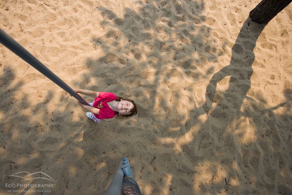 A young girl (age 4) plays at the playground at the North of Highland Campground near the Cape Cod National Seashore in Truro, Massachusetts.