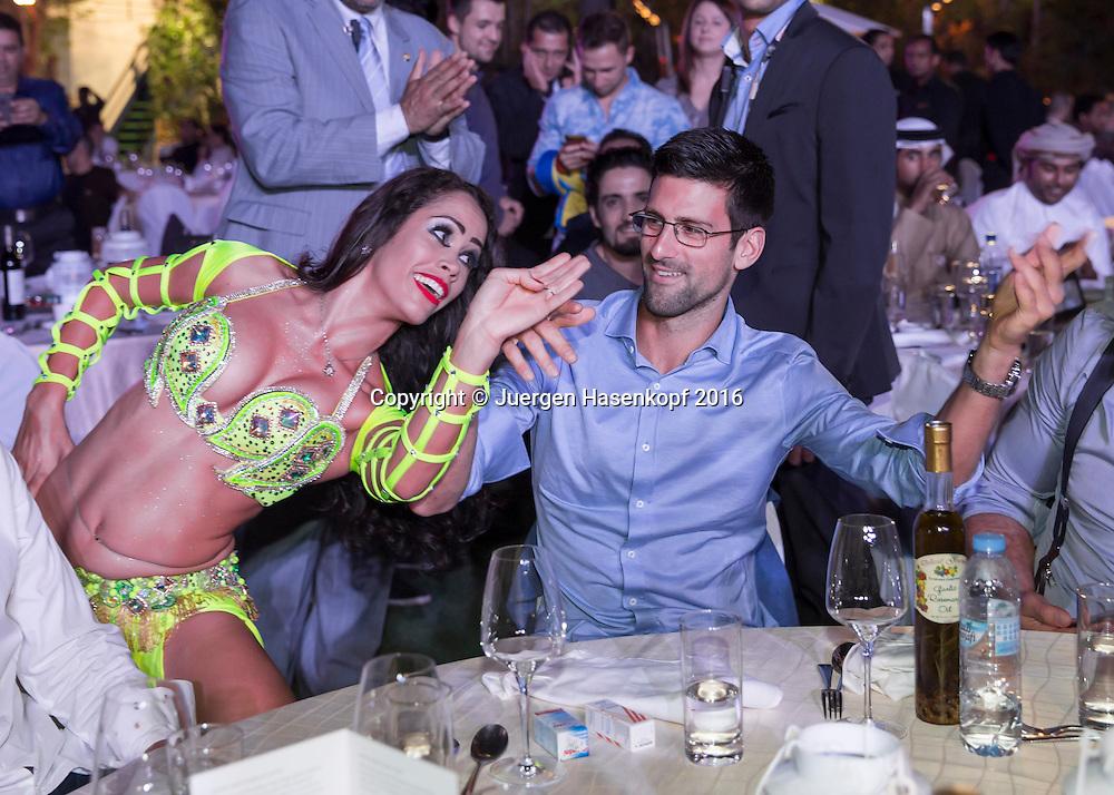 Dubai ATP Players Party, Novak Djokovic (SRB) und Bauchtaenzerin,<br /> <br /> Tennis - Dubai Duty Free Tennis Championships - ATP -   - Dubai -  - United Arab Emirates  - 23 February 2016. <br /> &copy; Juergen Hasenkopf
