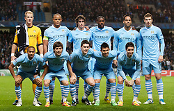 MANCHESTER, ENGLAND - Wednesday, December 7, 2011: Manchester City players line up for a team group photograph before the UEFA Champions League Group A match against FC Bayern Munchen at the City of Manchester Stadium. Front row L-R: Gael Clichy, David Silva, Gareth Barry, Sergio Aguero and Samir Nasri. Back row L-R: goalkeeper Joe Hart, captain Vincent Kompany, Stefan Savic, Yaya Toure, Joleon Lescott and Edin Dzeko. (Pic by Vegard Grott/Propaganda)