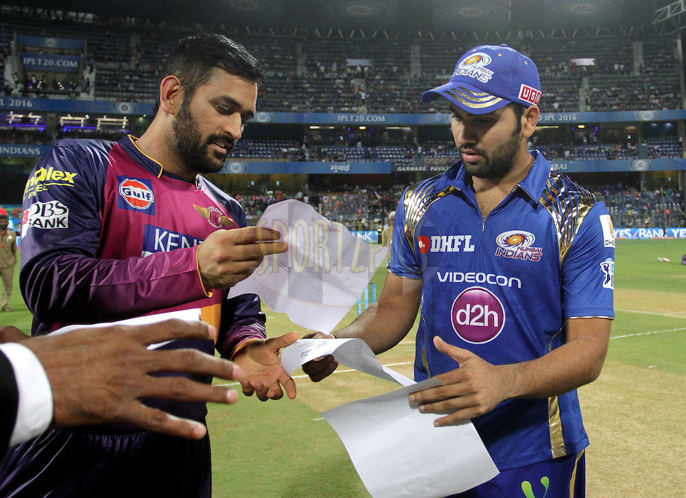 Rising Pune Supergiants captain MS Dhoni along with Mumbai Indians captain Rohit Sharma during the toss of the match 1 of the Vivo Indian Premier League ( IPL ) 2016 between the Mumbai Indians and the Rising Pune Supergiants held at the Wankhede Stadium in Mumbai on the 9th April 2016<br /> <br /> Photo by Vipin Pawar/ IPL/ SPORTZPICS