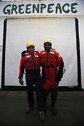 DAVIS STRAIT ABOARD ESPERANZA 16JUN11 - Greenpeace International executive director Kumi Naidoo of South Africa and Ulvar  Arnkvaern of Norway prepare to take action on the Greenpeace ship Esperanza in the Davis Stait off the coast of Greenland...Photo by Jiri Rezac / Greenpeace