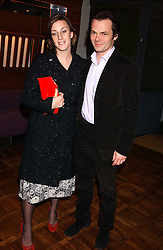 ALICE ELLIOT niece of Camilla Parker Bowles and her husband LUKE IRWIN at a party to celebrate the publication of 'E is for Eating' by Tom Parker Bowles held at Kensington Place, 201 Kensington Church Street, London W8 on 3rd November 2004.<br />