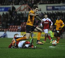 Swindon Town's Alex Pritchard tries to tackle Wolverhampton Wanderers' Sam Ricketts - Photo mandatory by-line: Alex James/JMP - Mobile: 07966 386802 11/03/2014 - SPORT - FOOTBALL - Swindon - County Ground - Swindon Town v Wolverhampton Wanderers - Sky Bet League One