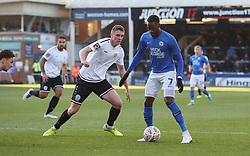 Mohamed Eisa of Peterborough United in action with Paul Rooney of Dover Athletic - Mandatory by-line: Joe Dent/JMP - 01/12/2019 - FOOTBALL - Weston Homes Stadium - Peterborough, England - Peterborough United v Dover Athletic - Emirates FA Cup second round