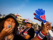 """29 DECEMBER 2013 - BANGKOK, THAILAND: An anti-government protestor near Democracy Monument in the old part of Bangkok protests against the ruling Pheu Thai party. Protest leader and former Deputy Prime Minister Suthep Thaugsuban announced an all-out drive to eradicate the """"Thaksin regime."""" The anti-government protesters have vowed to continue their protests even though the government has been dissolved and new elections called for in February. The protests have been ongoing in Bangkok since November and are growing increasingly violent.             PHOTO BY JACK KURTZ"""