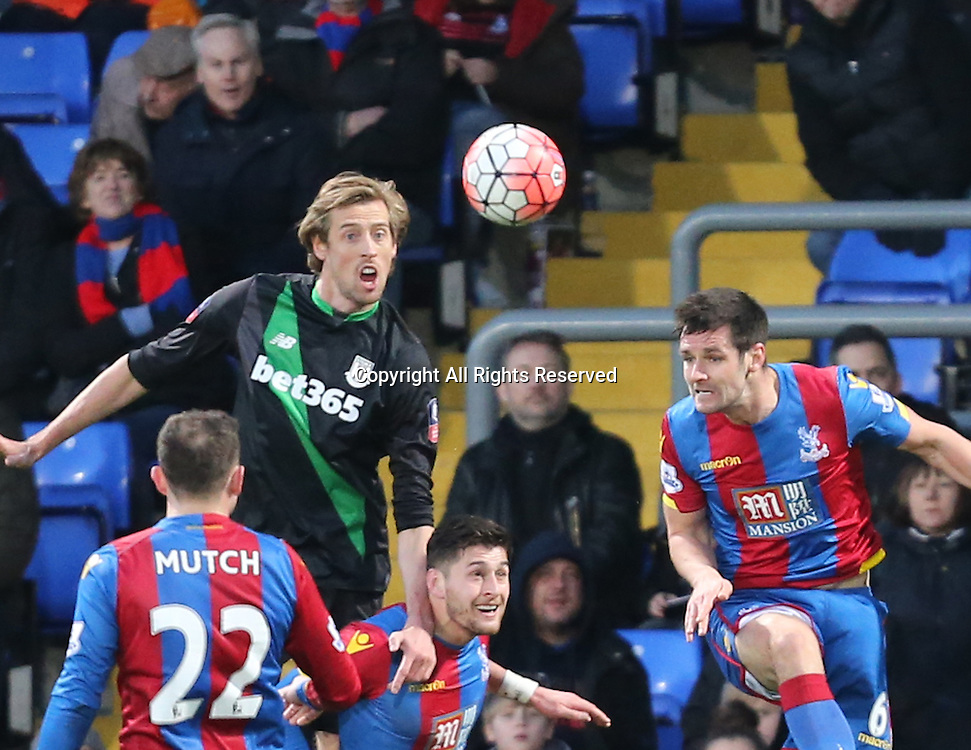 30.01.2016. Selhurst Park, London, England. Emirates FA Cup 4th Round. Crystal Palace versus Stoke. Peter Crouch climbs to head ball
