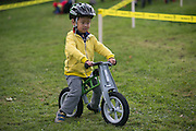 Andrew Lee, 3, of Brighton, rides on the children's course at the Ellison Park Cyclocross Festival in Rochester on Saturday, October 11, 2014.