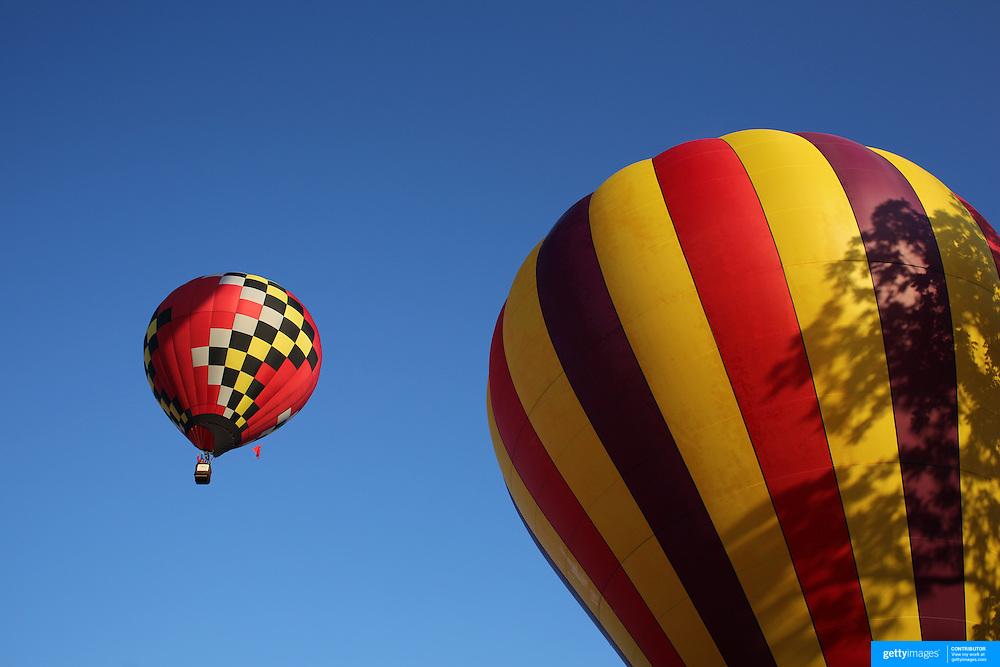 Hot Air balloons take to the skies around rural Michigan near Battle Creek during the World Hot Air Ballooning Championships. Battle Creek, Michigan, USA. 20th August 2012. Photo Tim Clayton