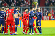 Tottenham Hotspur midfielder Giovani Lo Celso (18) receives a yellow card during the Champions League match between Bayern Munich and Tottenham Hotspur at Allianz Arena, Munich, Germany on 11 December 2019.