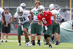 June 14, 2012; Florham Park, NJ, USA; New York Jets tight end Dustin Keller (81) and New York Jets quarterback Mark Sanchez (6) run sprints during New York Jets Minicamp at the Atlantic Health Training Center.