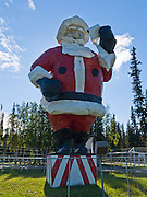 """The world's largest Santa Claus statue greets visitors to Santa Claus House in the Christmas themed town of North Pole (14 miles east of Fairbanks), Alaska, USA. Standing 42 feet high and weighing 900 pounds, this Santa was built for the 1962 World's Fair in Seattle, and then travelled promotionally until emplaced at North Pole in 1983. Saint Nicholas was born in Patara on the Aegean Sea coast of Anatolia (Asia Minor). As a Byzantine Christian bishop, Nicholas of Myra anonymously dropped gifts of coins down the chimneys of village girls who lacked dowries, thereby allowing them to marry and probably avoid a life of prostitution. After his death he was declared Saint Nicholas, patron saint of virgins, sailors, children, pawnbrokers, Holy Russia, and others. Saint Nicholas' town of Myra is now called Demre in the Republic of Turkey. The fame of Saint Nicholas grew in different cultures, such as in the Dutch figure of """"Sancte Claus,"""" and in the German legend of Christkindl (the Christ child) who was helped by the elf Belsnickle, imitated by adults in furs who brought gifts. These traditions evolved into Kris Kringle, as defined by Reverend Clement Moore in the famous 1822 poem """"A Visit From St. Nicholas"""" which starts: """" 'Twas the night before Christmas when all through the house / Not a creature was stirring not even a mouse... ."""" In the Civil War era of the United States of America, Thomas Nast further solidified the image of Kris Kringle in Harper's Magazine illustrations of a familiar white-bearded, gleaming-eyed man. Today in Turkey, Saint Nicholas is known as """"Noel Baba"""", or Father Christmas."""
