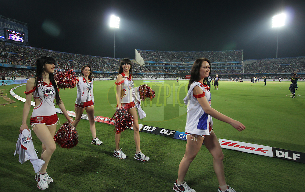Cheer girls walk in the break during match 15 of the Indian Premier League ( IPL ) between the Deccan Chargers and the Kings XI Punjab held at the Rajiv Gandhi International Cricket Stadium in Hyderabad on the 16th April 2011. Photo by Parth Sanyal/BCCI/SPORTZPICS