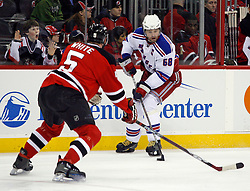 February 1, 2008; Newark, NJ, USA;  New York Rangers right wing Jaromir Jagr (68) skates in against New Jersey Devils defenseman Colin White (5) during the first period at the Prudential Center in Newark, NJ.