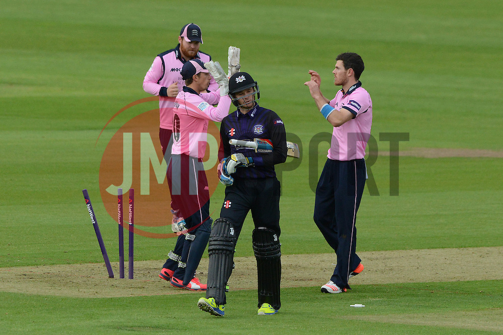 James Harris of Middlesex celebrates with team mates as Peter Handscomb of Gloucestershire is bowled out - Photo mandatory by-line: Dougie Allward/JMP - Mobile: 07966 386802 - 15/05/2015 - SPORT - Cricket - Bristol - Bristol County Ground - Gloucestershire County Cricket v Middlesex County Cricket - NatWest T20 Blast