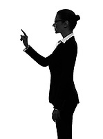 one  business woman touching copy sapce in silhouette on white background