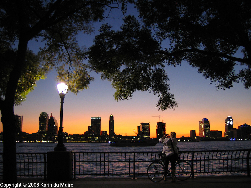Sunset over Hudson River as seen from Rockefeller Park in New York, NY. Beautiful sky!