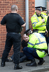 © licensed to London News Pictures. Hyde, UK  25/02/2012. Police detain EDL protesters following a demonstration in Hyde. The EDL demonstrate following an assault on Daniel Stringer-Prince. The victim's family said they did not want the EDL to demonstrate in their town in their son's name. It is alleged he was assulted by a gang of Asian men. At the same time, the BNP hold a rally in the town. Photo credit should read Joel Goodman/LNP