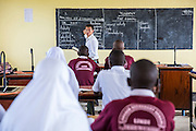 VSO volunteer Paul Jennings talks to students during a class taken with local teacher Rebecca Ngovano Paul has been working with Rebecca for over 6 months to improve teaching methodologies in classrooms. Angaza school, Lindi, Tanzania