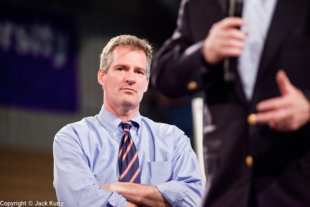 05 MARCH 2010 -- PHOENIX, AZ: Sen. Scott Brown listens to Sen John McCain at Grand Canyon University in Phoenix Friday. McCain is facing a tough primary battle from former Republican Congressman JD Hayworth. McCain has Scott Brown (R-MA) and Sarah Palin campaigning for him. Both men are courting the Tea Party activists but so far the Tea Party has refused to endorse either candidate.  PHOTO BY JACK KURTZ