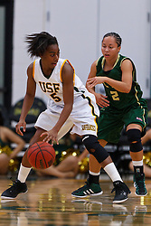 Nov 16, 2011; San Francisco CA, USA;  San Francisco Lady Dons guard Aundrea Gordon (5) is defended by Cal Poly Mustangs guard Jonae Ervin (2) during the first half at War Memorial Gym.  Cal Poly defeated San Francisco 80-66. Mandatory Credit: Jason O. Watson-US PRESSWIRE