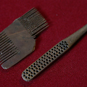 A Tudor comb and Victorian toothbrush which have been excavated from the River Thames by mudlarker Jason Sandy are displayed in his home in London, Britain June 01, 2016. When the river Thames is at low tide, mudlarkers scour the shore for historical artefacts and remains from there City of London's ancient past. Finds can date back to Roman times to when the city was found up until more recent times. Anyone can walk along the river and look for finds, but the uses of metal detectors and digging is restricted. Mudlarkers need to be licences by the Port of London Authority. All find should be register with the Museum of London. REUTERS/Neil Hall