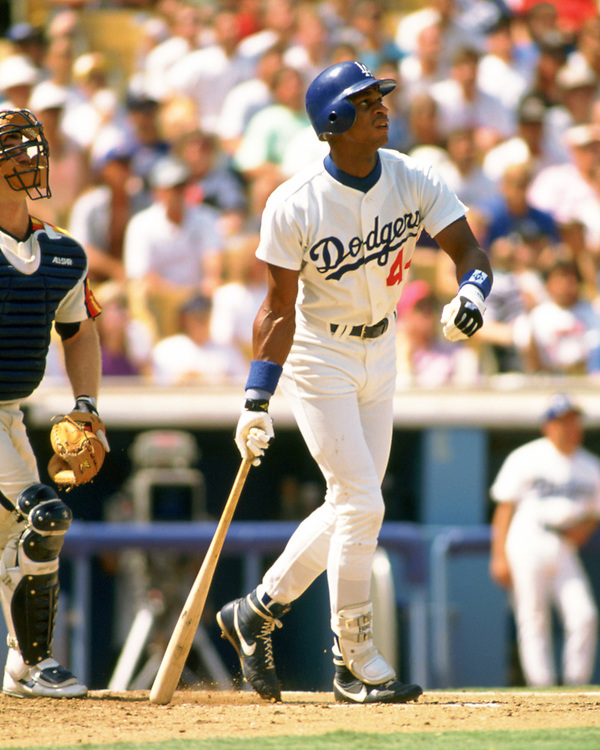 LOS ANGELES - 1989:  Darryl Strawberry of the Los Angeles Dodgers bats during an MLB game at Dodger Stadium in Los Angeles, California during the 1989 season.  (Photo by Ron Vesely).  Subject:   Darryl Strawberry