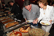 Michael Smith of Riverside and Linda Hoyng of Beavercreek (right) as Riverside Area Chamber of Commerce hosts an International Night featuring Indian and American food at the Filling Station Sports Bar & Grill in Riverside, Monday, March 26, 2012.  Owner Doctor Suresh Gupta prepared Indian cuisine including Bean Sprout Cucumber Salad, Butter Chicken, Samosas, Rice/Naan Bread and Veggie Khorma.
